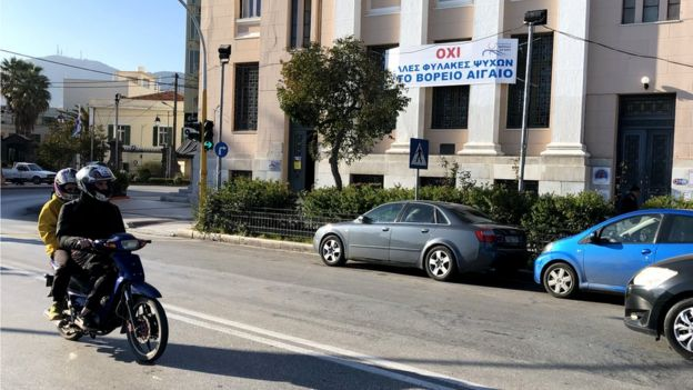 """Banner reads: """"No more prisons for human souls in the North Aegean."""""""