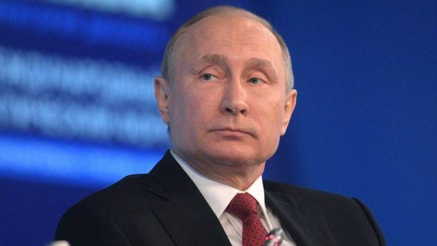 Russian President Vladimir Putin attends an Arctic forum on Thursday