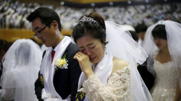 Image Copyright Reuters Newlywed Couples Attend A Mass Wedding Ceremony Of The Unification Church At Cheongshim Peace World Centre