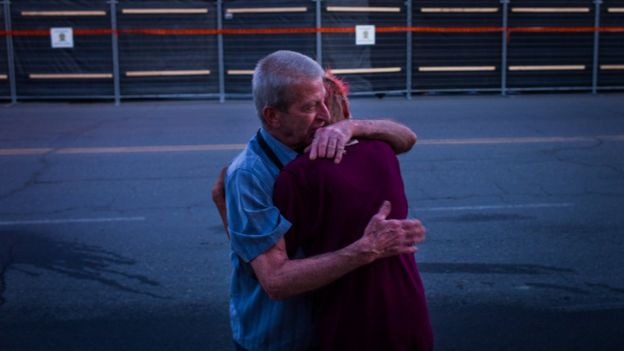 Marcel Larrivee (L) comforts Patricia Landry after the pair first witnessed the aftermath of the destruction
