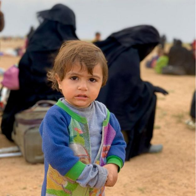 One child and several women in a refugee camp in Syria