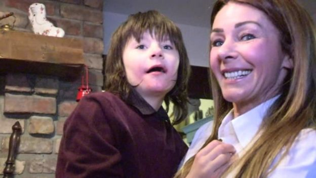 A boy with severe epilepsy has been given back medicinal cannabis oil that was confiscated from his mother at customs, the home secretary has said.