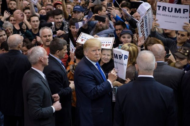 Donald Trump signs autographs during a rally at the International Exposition Center March 12, 2016 in Cleveland, Ohio