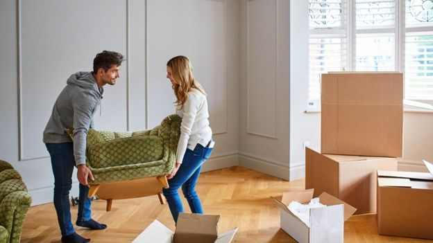 A young couple moving into a property