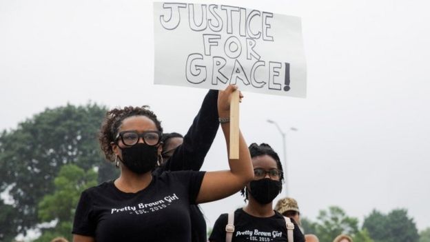 Protesters hold up a sign saying: Justice for Grace, at a rally in Pontiac, Detroit, on 16 July 2020