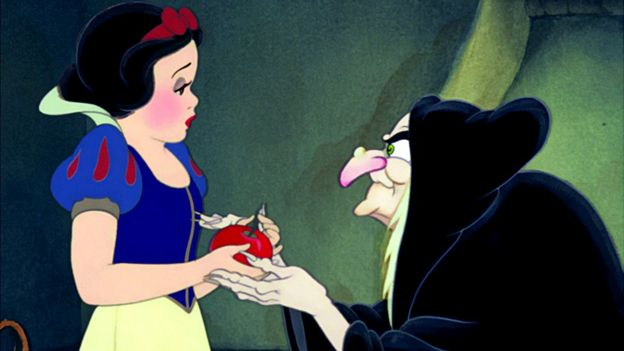 Snow White accepting poisoned apple, from Disney film
