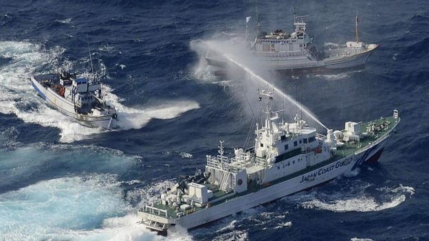 A Japan Coast Guard vessel (lower) sprays water against Taiwanese fishing boats, in the East China Sea near the Senkaku islands as known in Japanese or Diaoyu Islands in Chinese on September 25, 2012.