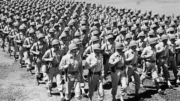 Soldiers marching during the 1940s