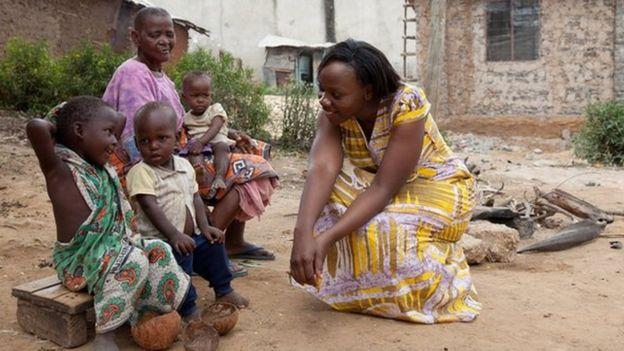 Phyllis Omido talking to children