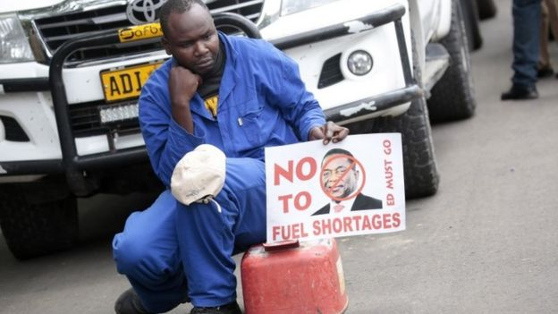 A protester with a fuel container, due to the continuing fuel crisis,as Movement For Democratic Change (MDC) Alliance party members gather in the Africa Unity Square, in Harare, Zimbabwe, 29 November 2018, to protest against the current economic situation facing the country.