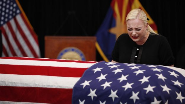 Meghan McCain, daughter of Senator John McCain, cries over his coffin
