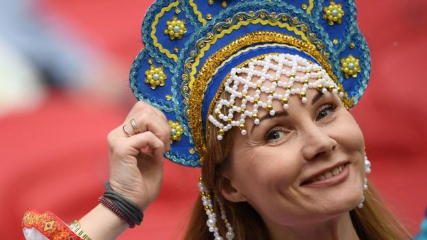A female Russian football supporter wearing traditional headwear