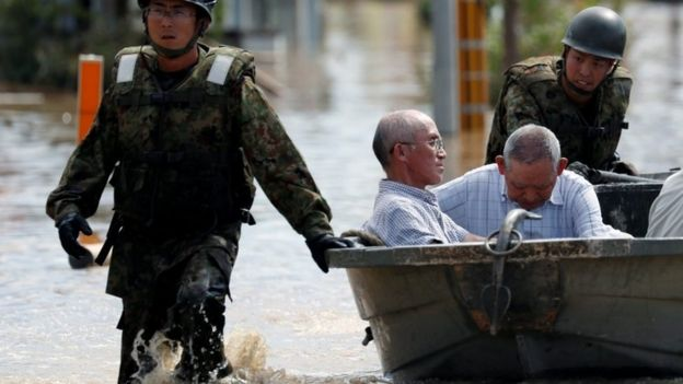 Japan Self-Defence Force soldiers rescue people from a flooded area in Mabi