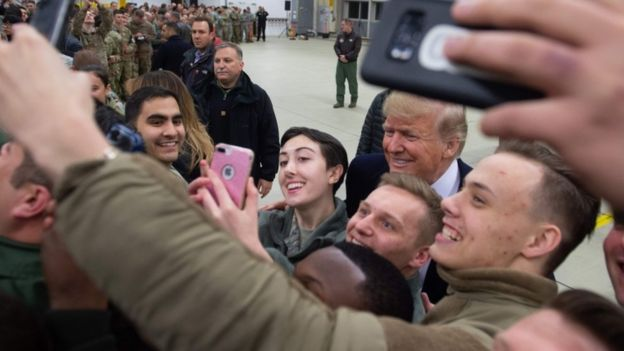 US President Donald Trump greets members of the US military during a stop at Ramstein Air Base in Germany, 27 December