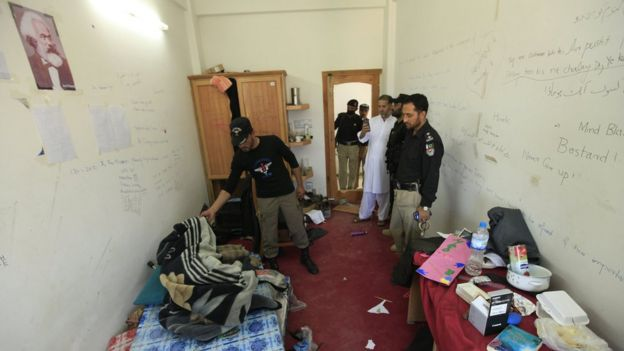 Pakistani security officials survey the room of student Mashal Khan at Abdul Wali Khan University, where he was killed by a mob of his fellow students for alleged blasphemy in Mardan