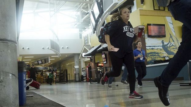 Passengers run for cover in Terminal 1 at Fort Lauderdale's