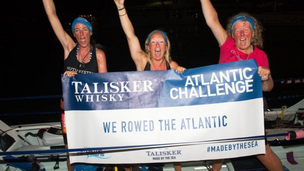 (L-R) Bird Watts, Claire Allinson and Mo O'Brien after they reached the finish line