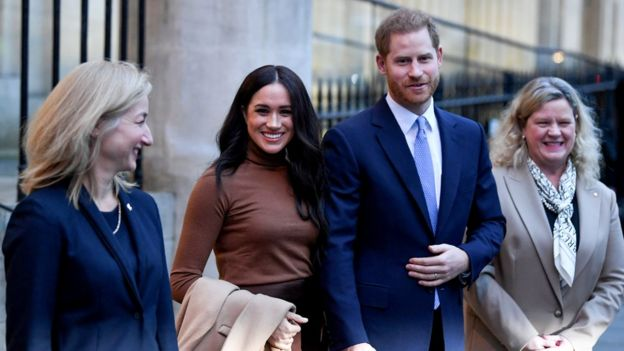 """Britain""""s Prince Harry and his wife Meghan, Duchess of Sussex stand with High Commissioner for Canada in the United Kingdom Janice Charette and deputy High Commissioner Sarah Fountain Smith as they leave after their visit to Canada House in London"""