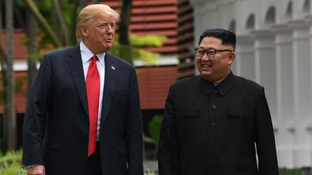 "In this file photo taken on June 11, 2018 North Korea""s leader Kim Jong Un (R) walks with US President Donald Trump (L) during a break in talks at their historic US-North Korea summit, at the Capella Hotel on Sentosa island in Singapore."