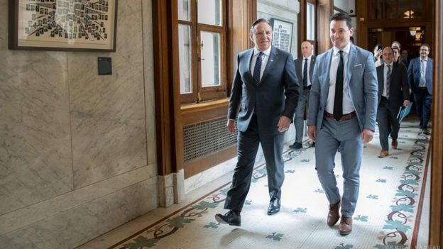 Quebec Premier Francois Legault (L) and Immigration and Diversity Minister Simon Jolin-Barette (R)