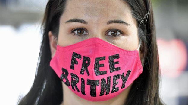 Britney Spears fan wearing a 'Free Britney' mask outside court in July