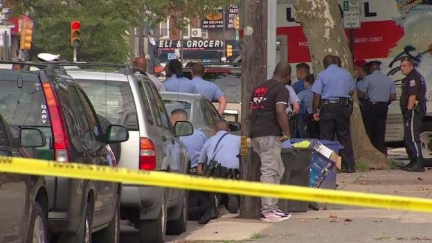 The gunman opened fire as officers served a drug warrant at a home in Philadelphia