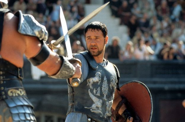 Russell Crowe facing off against another man in a scene from the film 'Gladiator', 2000. (Photo by Universal/Getty Images)