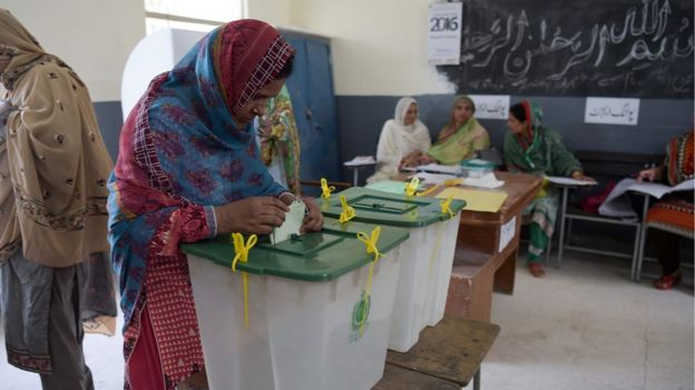 """A woman casts her vote during Pakistan""""s general election"""