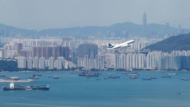 Cathay plane over Hong Kong