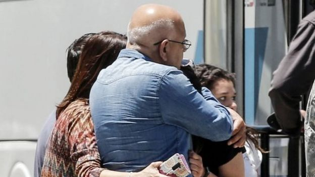 Relatives of people aboard the Chilean Air Force C-130 Hercules cargo plane that went missing embrace at the Cerrillos base in Santiago