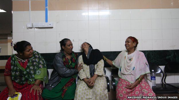 Relatives of victims wait at the hospital where they were being treated
