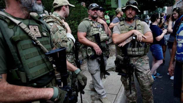 Members of a white supremacists militia stand near a rally in Charlottesville, Virginia