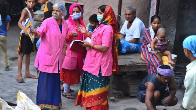 Asha health workers talk amongst themselves while conducting door to door survey to identify Covid-19 cases as JJ colony in Patparganj has already reported above 70,000 cases, near Mayur Vihar on June 25, 2020 in New Delhi, India