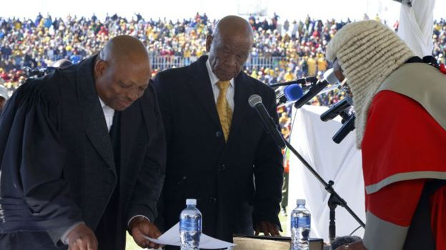 Newly appointed Lesotho prime Minister Thomas Thabane (L), leader of the All Basotho Convention (ABC) political party, is sworn in on June 16, 2017