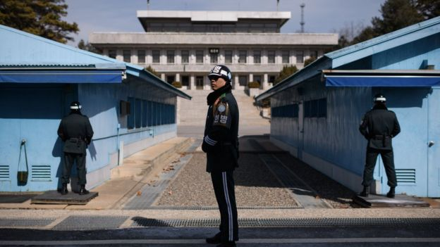 A South Korean soldier stands before the military demarcation line in the village of Panmunjom, within the Demilitarised Zone dividing the two Koreas, in 2018
