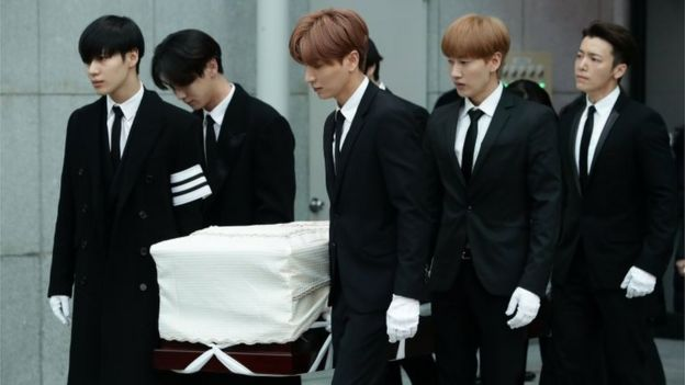 Members of pop Idol SHINee and Super Junior carry the coffin containing the body of Jonghyun of SHINee during the funeral at the hospital on December 21, 2017 in Seoul, South Korea.