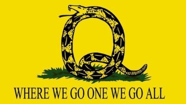 """Picture of a snake in the shape of a letter Q and the slogan """"where we go one we go all"""""""