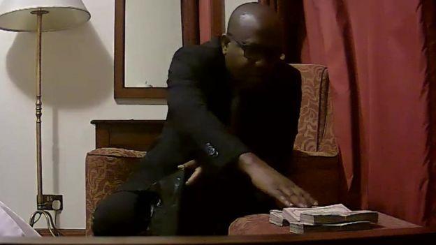 Kwesi Nyantakyi reaches for piles of cash