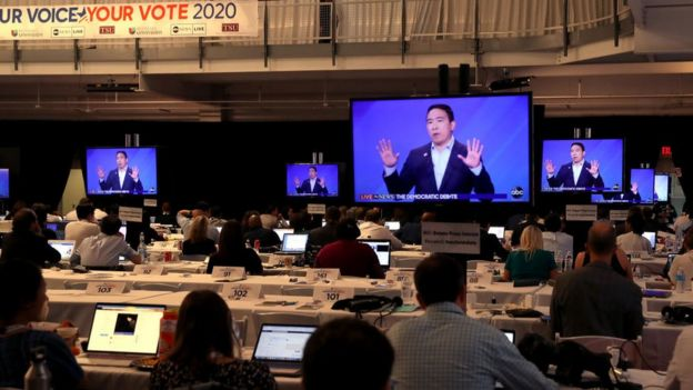 Journalists watch Yang during the Houston Democratic debate