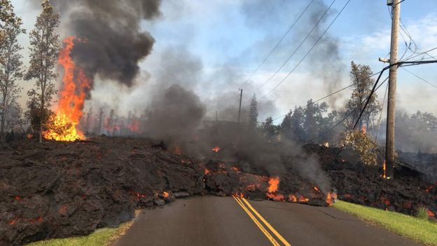 This image released by the US Geological Survey shows lava from a fissure slowly advancing to the northeast on Hookapu Street in Leilani Estates, Hawaii, on May 5, 2018.