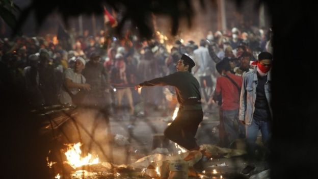 Protesters hurl missiles towards police during renewed clashes on Wednesday