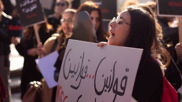 Women protesting about masturbation photos
