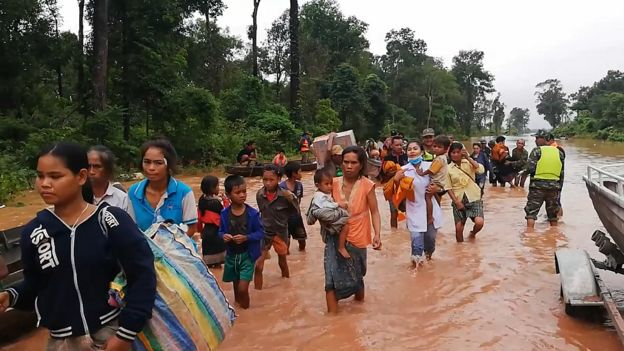 Villagers rescued from flooding after dam collapses. Picture: Attapeu Today