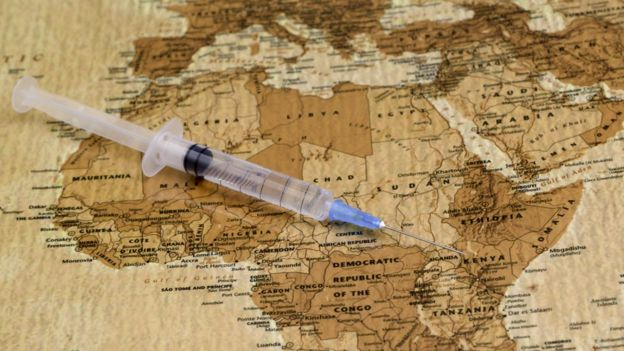Map with a vaccination syringe