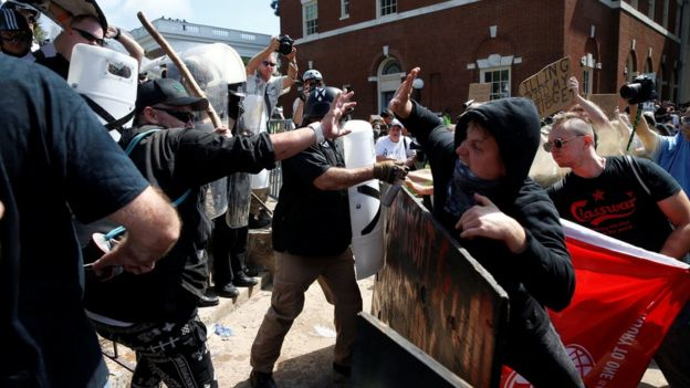 Members of white nationalists clash against a group of counter-protesters in Charlottesville Virginia