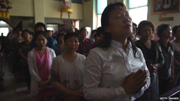 Chinese Catholics attend a mass