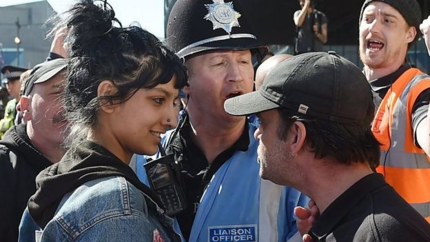 Saffiyah Khan smiling at an EDL protester. Photo: 8 April 2017