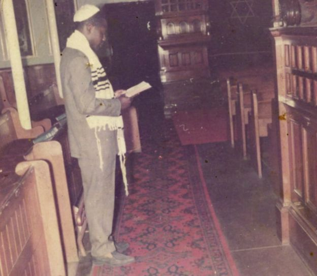 Man worshipping in a synagogue
