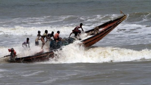 Fishermen return from the Bay of Bengal's eastern coast beach at Konark after Cyclone Fani alert