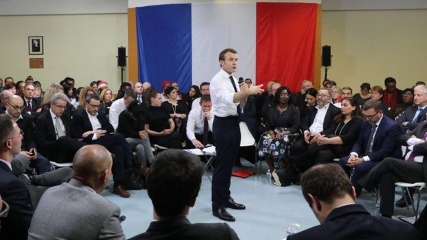 """Emmanuel Macron attends a meeting as part of the """"great national debate"""" in Evry-Courcouronnes, France February 4, 2019"""